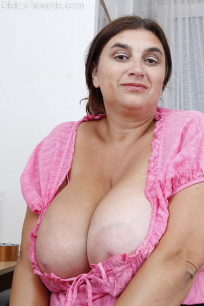 image Horny milf with huge boobs sucking